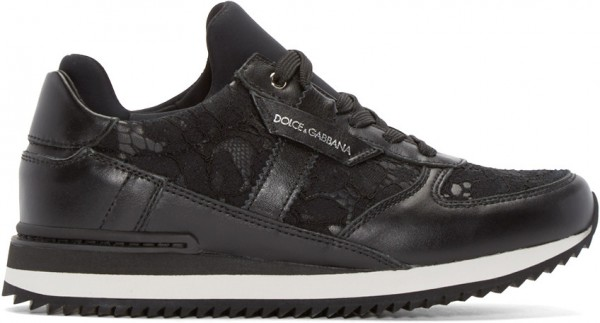 Low-top buffed leather sneakers in black. Tonal lace panelling throughout. Round toe. Tongue and inner collar in tonal neoprene. Logo patch at outer side. Treaded rubber sole. Tonal stitching. Upper: leather, textile. Sole: rubber. Made in Italy.